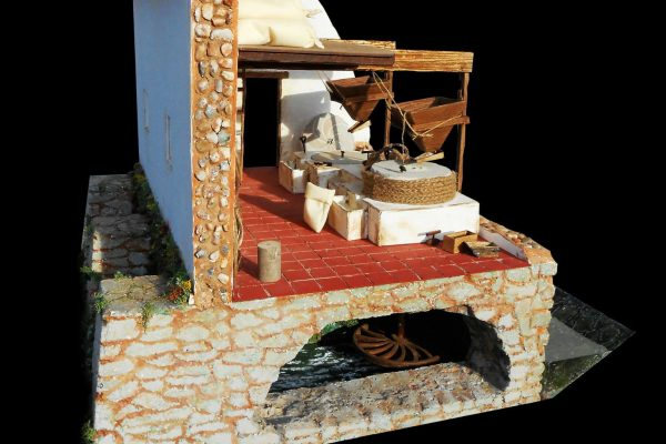 Maqueta de un molino hidráulico harinero de rodezno y rampa medieval